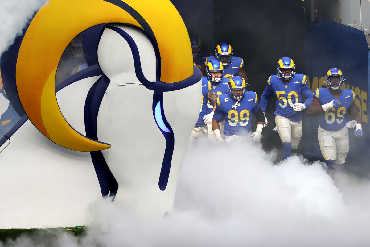 Aaron Donald #99, Samson Ebukam #50, and Sebastian Joseph-Day #69 of the Los Angeles Rams take the field prior to a game against the Arizona Cardinals at SoFi Stadium on January 03, 2021 in Inglewood, California.
