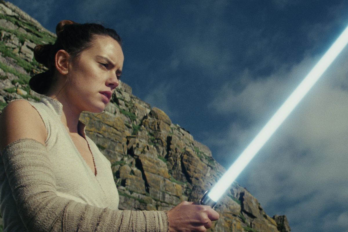 Star Wars: The Last Jedi - Rey (Daisy Ridley) holds her lightsaber