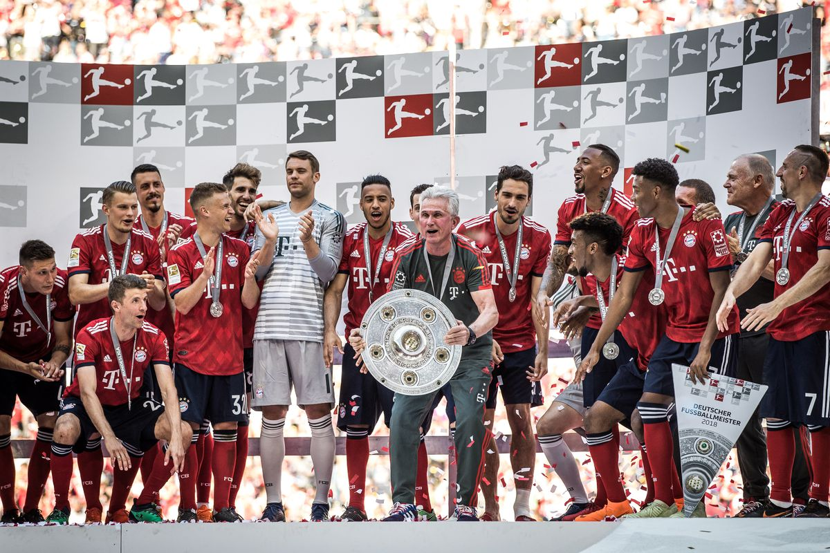 FC Bayern Muenchen v VfB Stuttgart - Bundesliga MUNICH, GERMANY - MAY 12: Players of Bayern Munich and Head Coach Jupp Heynckes of Bayern Munich celebrate with the trophy during the celebration for the 28th German football championship after the Bundesliga match between FC Bayern Muenchen and VfB Stuttgart at Allianz Arena on May 12, 2018 in Munich, Germany
