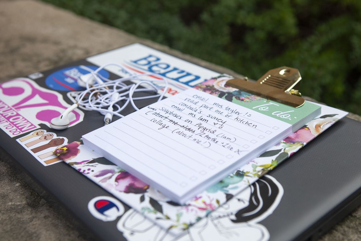 Trinity's to do list and headphones placed on top of her laptop.