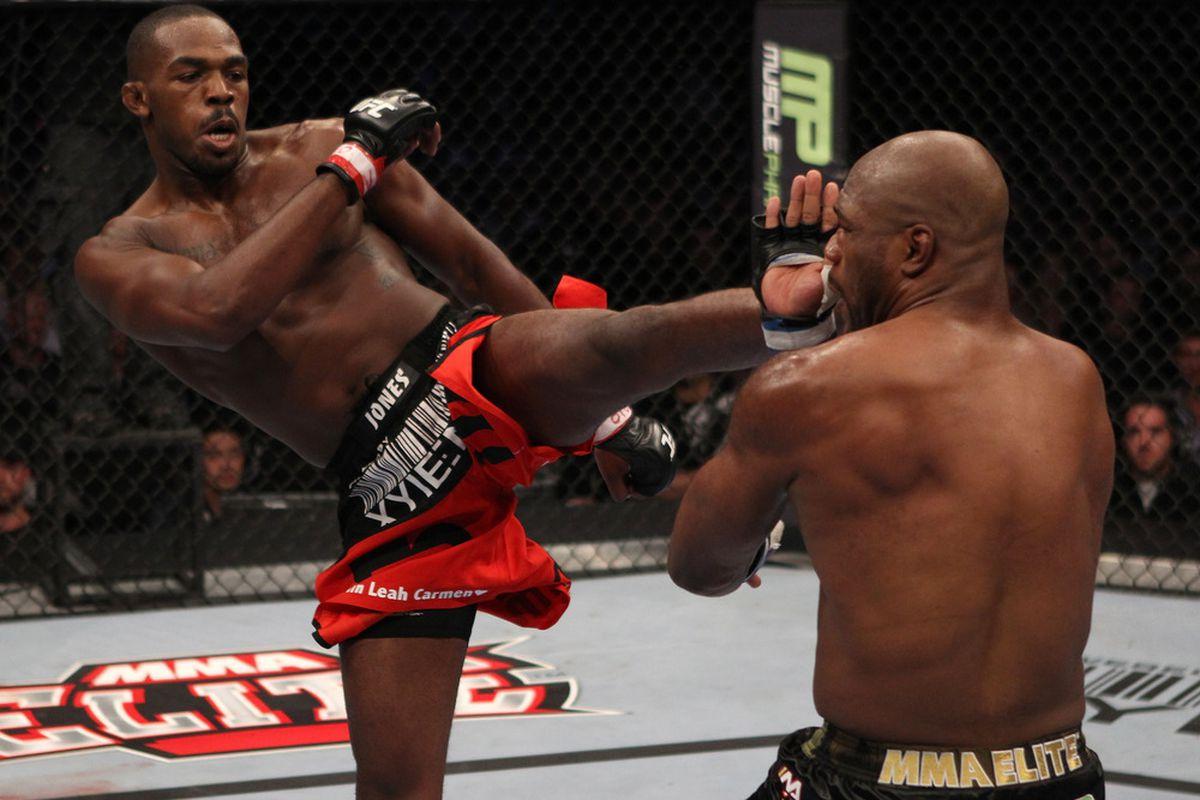 DENVER, CO - SEPTEMBER 24: (L-R) Jon Jones kicks Quinton 'Rampage' Jackson during the UFC 135 event at the Pepsi Center on September 24, 2011 in Denver, Colorado. (Photo by Jed Jacobsohn/Zuffa LLC/Zuffa LLC)