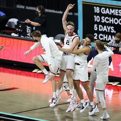Gonzaga players celebrate as they defeat BYU in the finals of the West Coast Conference tournament at the Orleans Arena in Las Vegas on Tuesday, March 9, 2021. Gonzaga won 88-78.