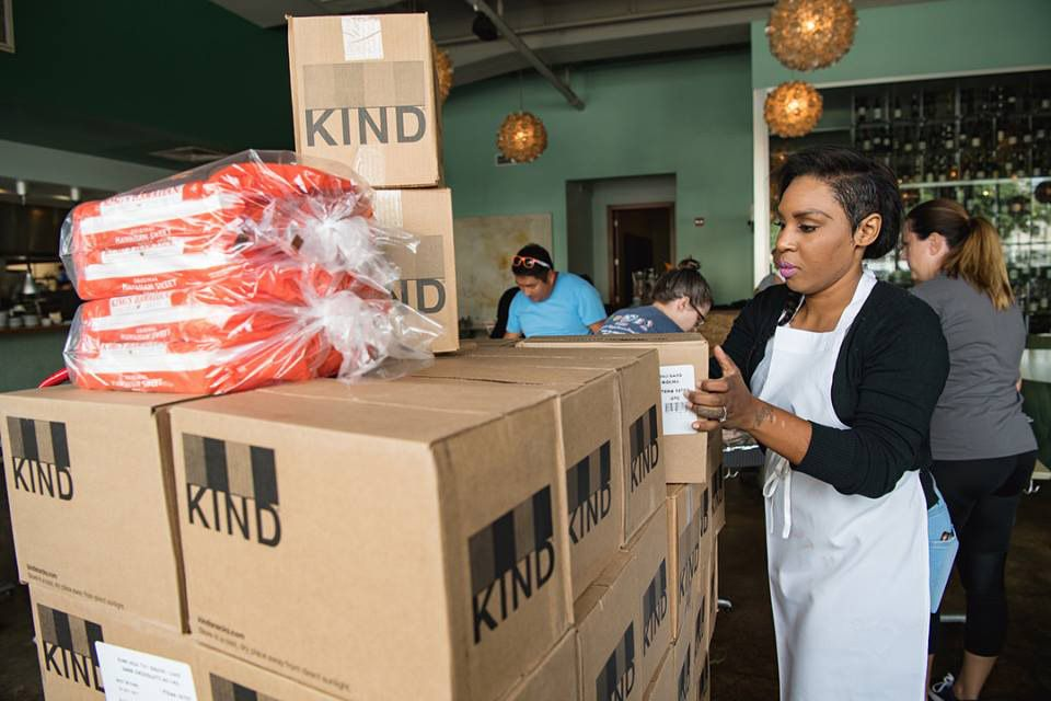 Employees at Reef in Houston receive food for the relief effort.