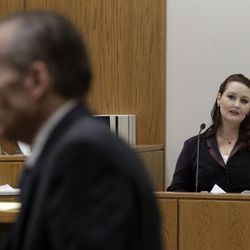Gypsy, Willis who carried on an affair with Martin MacNeill, looks toward Martin MacNeill during a recess in his murder trial in 4th District Court in Provo Thursday Nov. 7, 2013. She read portions of love letters the two exchanged while serving time in federal prison for document fraud.