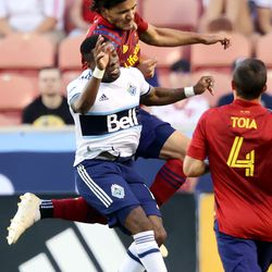 Vancouver Whitecaps forward Cristian Dajome (11) and Real Salt Lake defender Marcelo Silva (30) go up high after the Ball as Real Salt Lake and Vancouver FC play at Rio Tinto Stadium in Sandy on Wednesday, July 7, 2021.