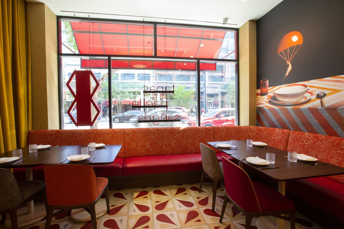 A restaurant's colorful (reds) decor with seats.