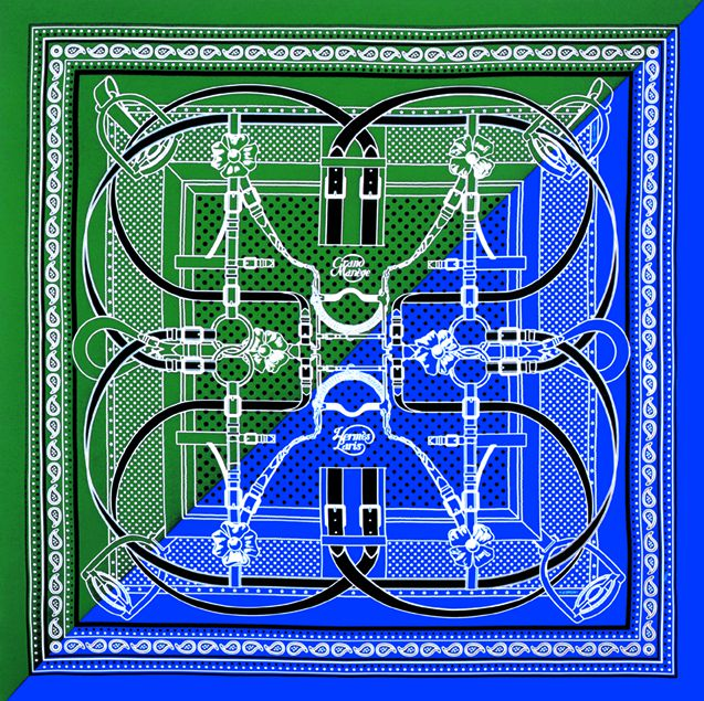 A square scarf bisected on the diagonal, with one side shaded blue and the other forest green. White and black buckle designs crisscross it.