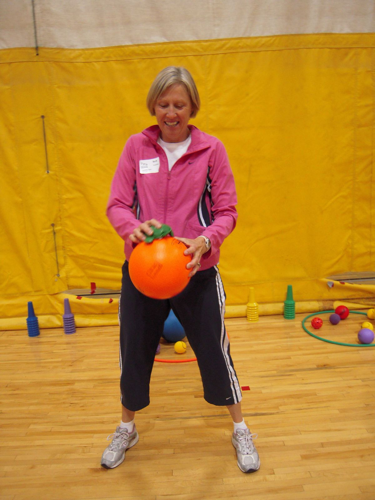 Barb Francklyn, P.E. teacher at Foothills Elementary in Colorado Springs, tries bouncing a ball with a frog-shaped beanbag atop it.