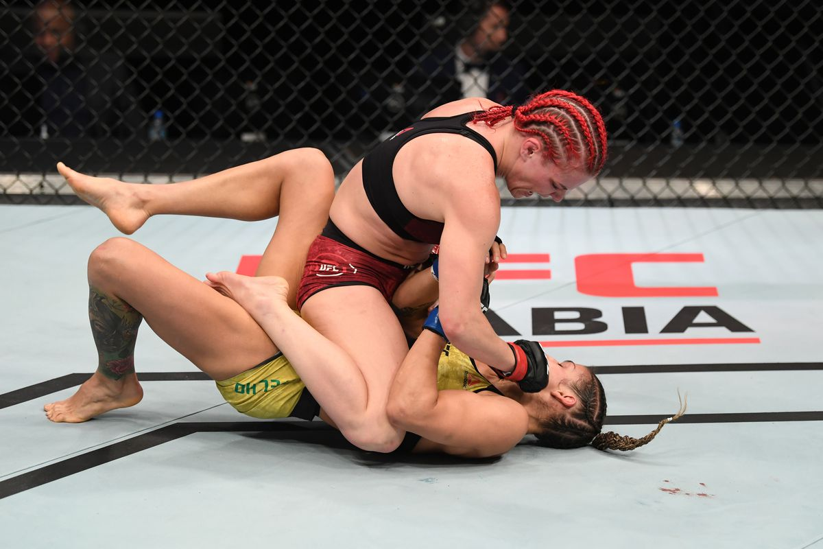 In this handout image provided by UFC, Gillian Robertson punches Poliana Botelho of Brazil in their women's flyweight bout during the UFC Fight Night event inside Flash Forum on UFC Fight Island on October 18, 2020 in Yas Island, Abu Dhabi, United Arab Emirates.