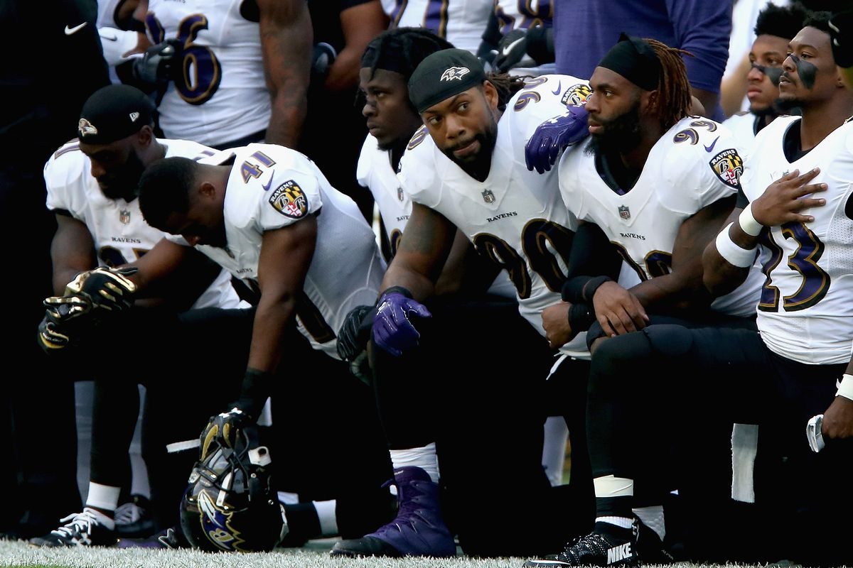 Jaguars, Ravens players kneel during anthem amid Trump's criticism