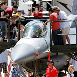 Spectators check out the cockpit of an F-16 Saturday as thousands turn out for the Hill Air Force Base air show.