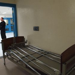 Mark Ellsworth, a health authority at the Salt Lake County Jail stands outside a room with a hospital bed in the acute medical area on Nov. 23, 2005.