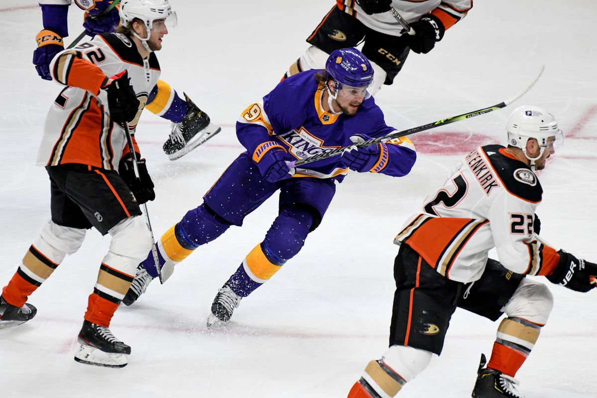 Anaheim Ducks Left Wing Alexander Volkov (92), Los Angeles Kings Winger Adrian Kempe (9) and Anaheim Ducks Defenceman Kevin Shattenkirk (22) skate towards the puck during an NHL game between the Anaheim Ducks and the Los Angeles Kings on April 26, 2021, at the Staples Center in Los Angeles, CA.
