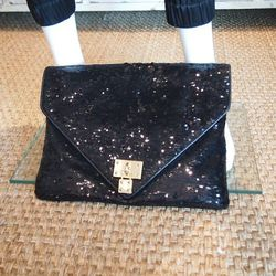 """Lawson chooses AH by Alexis Hudson's """"Ciara"""" Sequin Envelope Clutch ($195) for its sparkle—a must for the occasion."""
