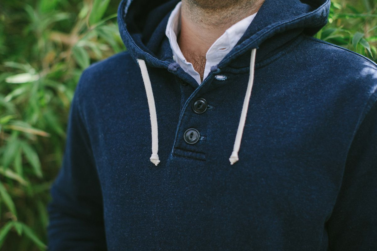 """Image via <a href=""""http://taylorstitch.com/collections/mens-basics/products/indigo-3-button-hooded-sweatshirt"""">Taylor Stitch</a>."""