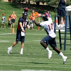Peyton Manning throws to Gerell Robinson during drills on day two of training camp