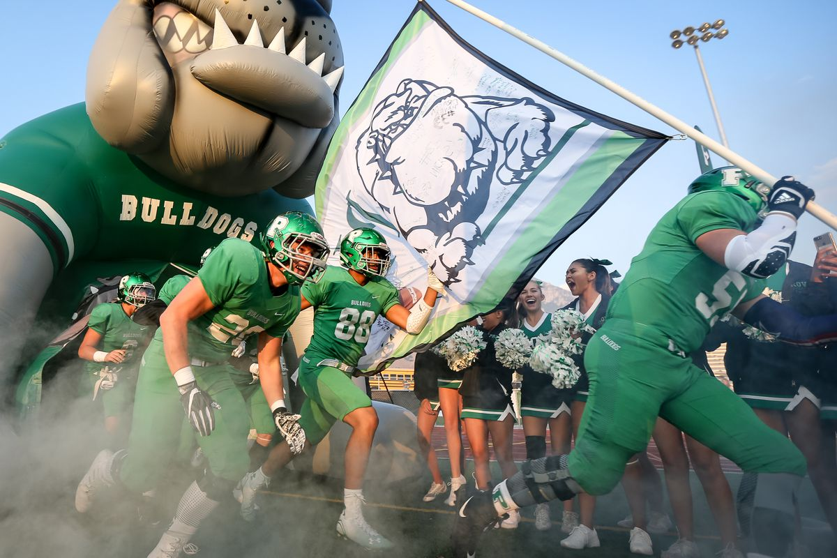 The Provo High School Bulldogs take the field as Orem High School takes at Provo High School in Provo on Friday, Sept. 15, 2017.