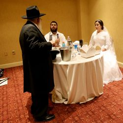 After the ceremony under the chuppah, Rabbi Mendy Cohen and Chaya Zippel retreat to the yichud, or seclusion room, where they break their wedding day fast and spend a few minutes with each other during a traditional Chabad Lubavitch Jewish wedding at the Grand America Hotel in Salt Lake City on Monday, Sept. 12, 2016.