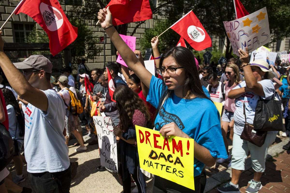 In a rally in support of DACA, activists marched and carried signs and flags.