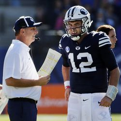 Offensive coordinator and quarterbacks coach Ty Detmer talks with Brigham Young Cougars quarterback Tanner Mangum during NCAA football against the San Jose State Spartans in Provo on Saturday, Oct. 28, 2017.