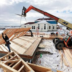 Workers from Dawson building systems put up a wall of a home being built in Daybreak on Friday, Feb. 3, 2017. According to the 2017 Salt Lake Housing Forecast report released on Friday by the Salt Lake Board of Realtors, the Salt Lake County real estate market in 2016 had its best year in a decade.