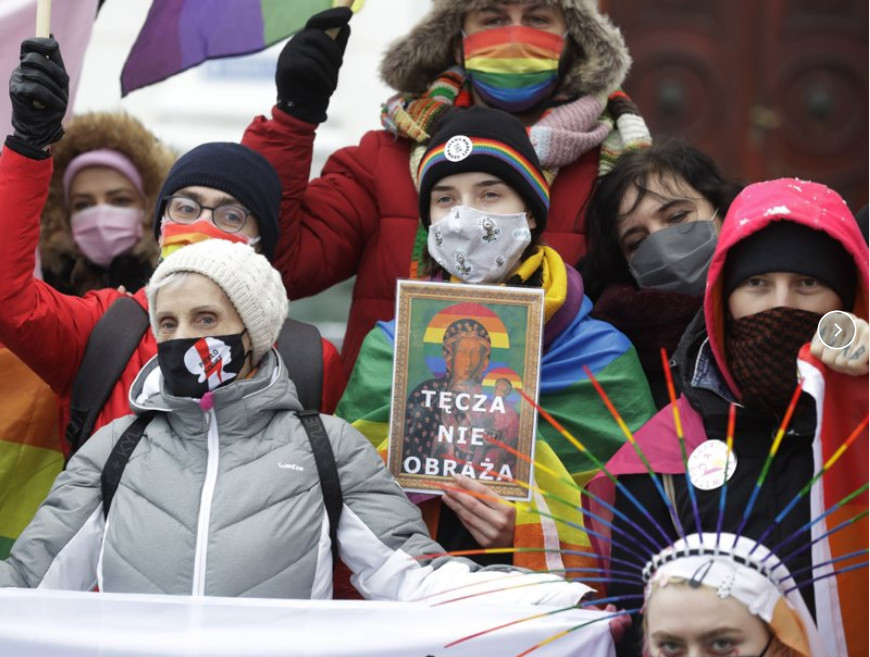 Human rights activists show an altered image with colors symbolizing LGBTQ rights as they gathered outside the provincial court in Plock, Poland, when three activists went on trial on charges of having offending religious sentiment by adding the LGBT rainbow symbol to posters of the revered icon, The Black Madonna and Baby Jesus, and publicly displaying the altered image on garbage bins and mobile toilets.