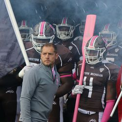 Coach PJ Fleck prepares to lead his team out on the field