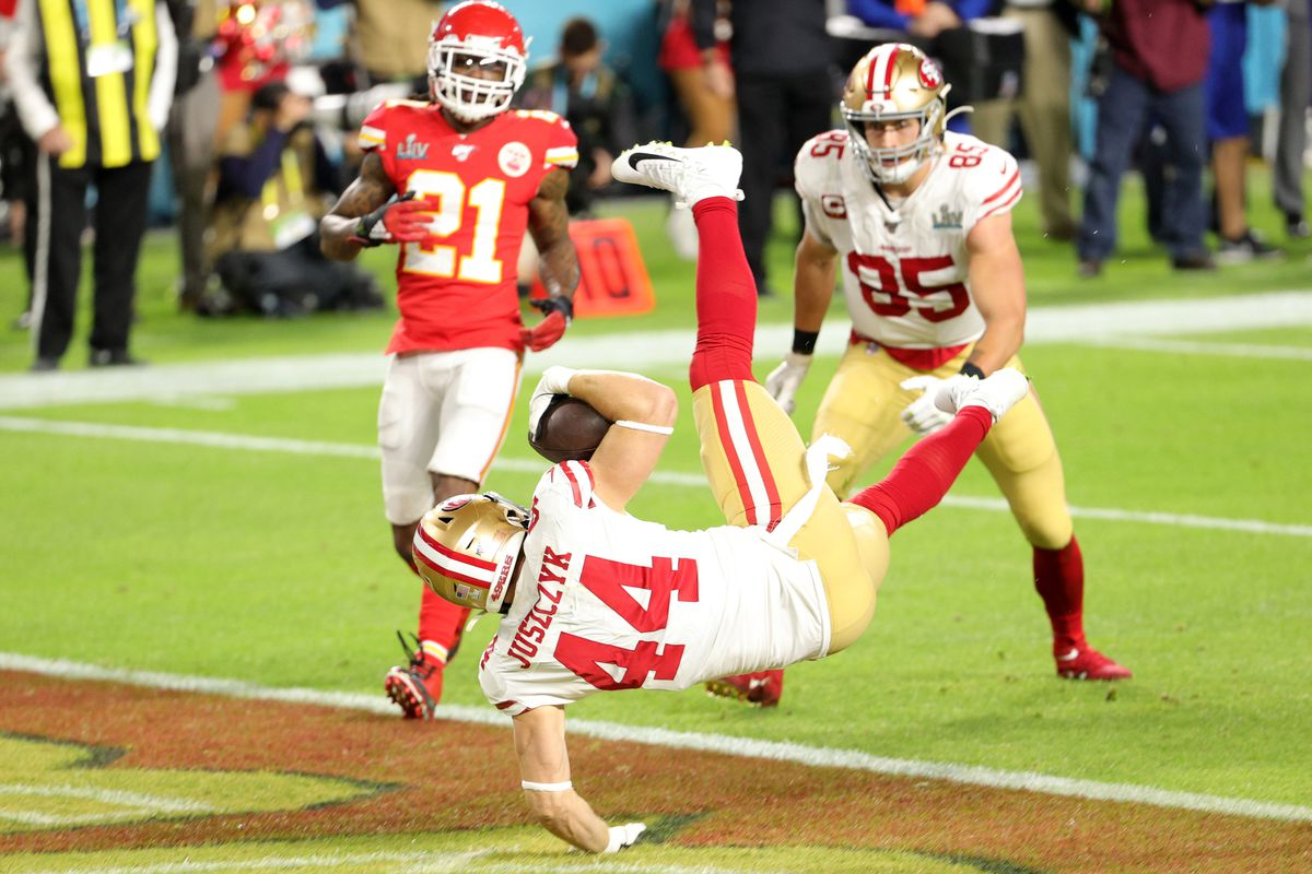 Kyle Juszczyk of the San Francisco 49ers scores on 15-yard touchdown reception in the second quarter of Super Bowl LIV against the Kansas City Chiefs at Hard Rock Stadium on February 02, 2020 in Miami, Florida.