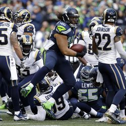 Seattle Seahawks fullback Will Tukuafu (46) reacts after climbing out of a pile of players with the football in the first half of an NFL football game against the St. Louis Rams, Sunday, Dec. 28, 2014, in Seattle.