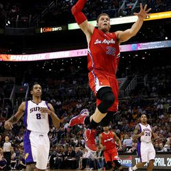Los Angeles Clippers' Blake Griffin (32) drives past Phoenix Suns' Channing Frye (8) during the first half of an NBA basketball game, Thursday, April 19, 2012, in Phoenix.