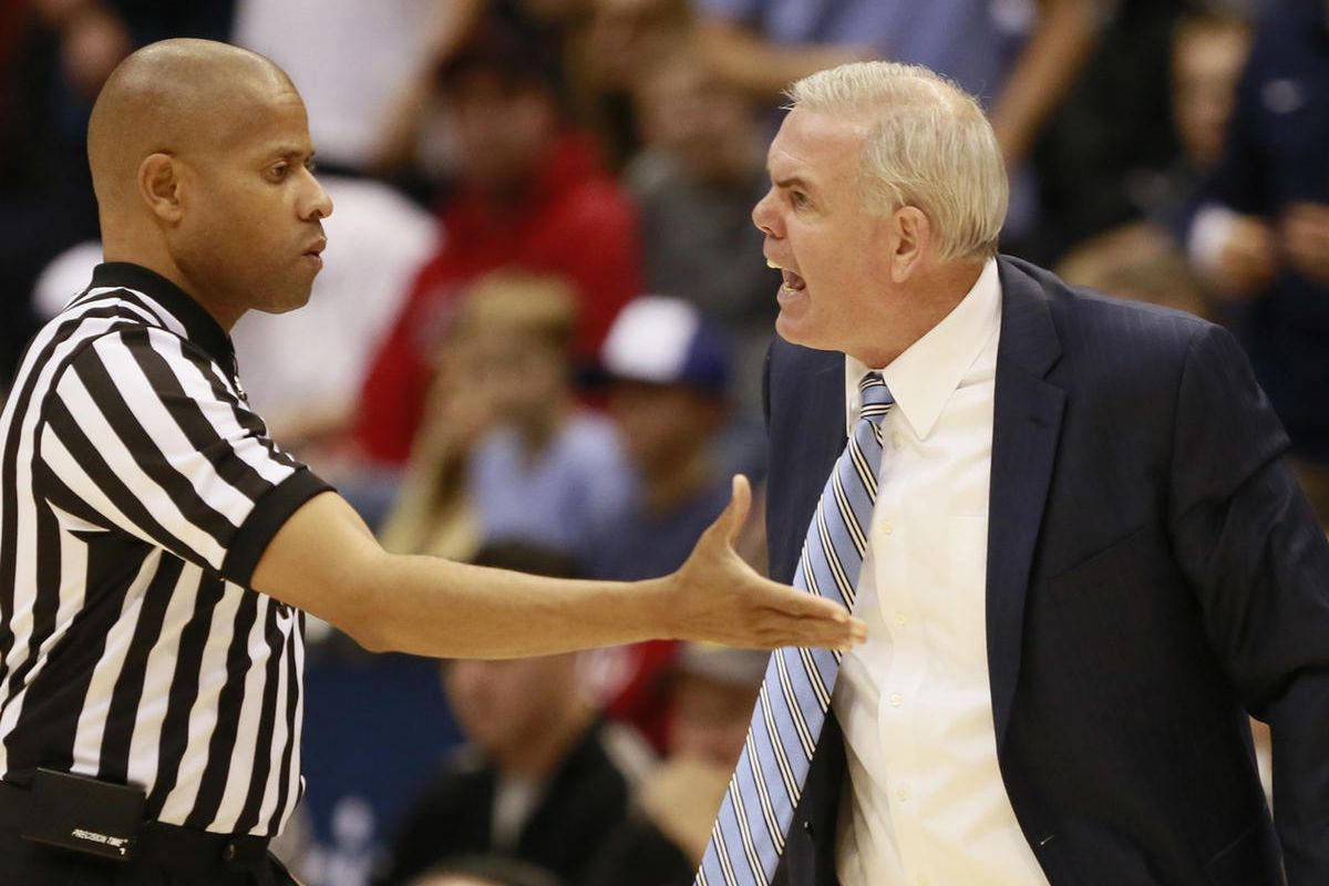 Brigham Young Cougars head coach Dave Rose yells at a referee during the game against Utah Utes in the Marriott Center Wednesday, Dec. 10, 2014, in Provo.