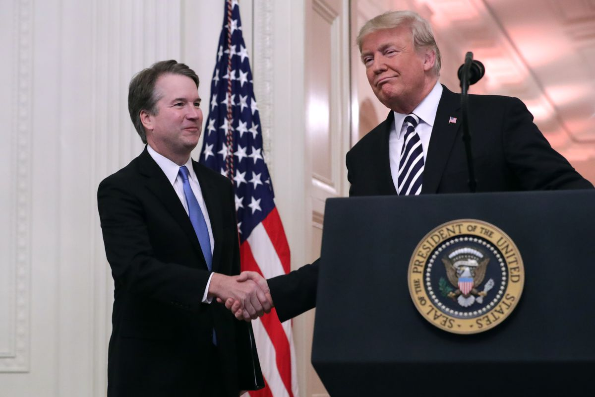 President Donald Trump shakes hands with Supreme Court Justice Brett Kavanaugh after he's sworn in.