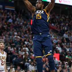 Utah Jazz forward Derrick Favors (15) dunks during the game against the Cleveland Cavaliers at Vivint Arena in Salt Lake City on Saturday, Dec. 30, 2017.