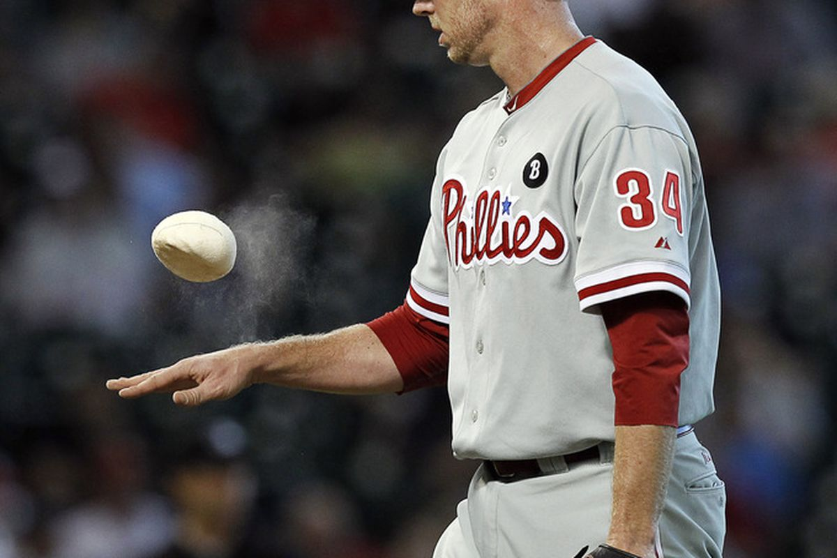 HOUSTON - SEPTEMBER 14:  Pitcher Roy Halladay #34 of the Philadelphia Phillies goes to the rosin bag during a baseball game against the Houston Astros at Minute Maid Park on September 14, 2011 in Houston, Texas.  (Photo by Bob Levey/Getty Images)