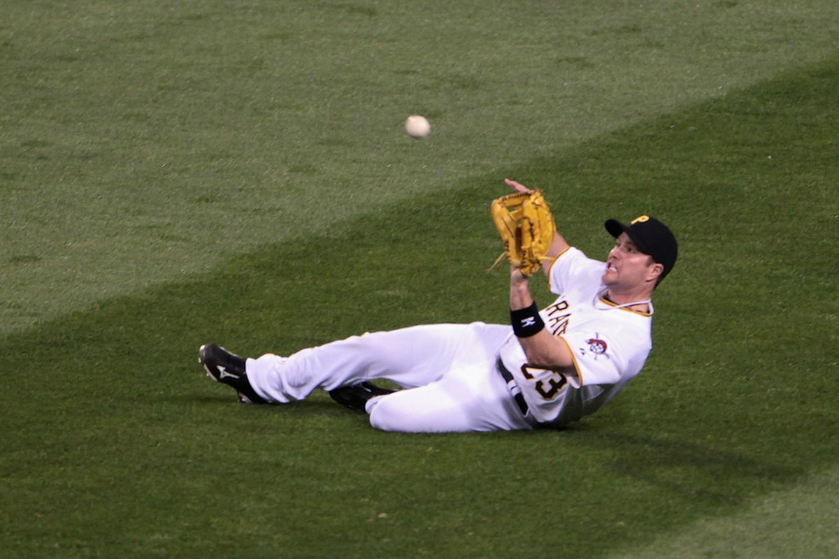 PITTSBURGH, PA - APRIL 14:  Matt Diaz #23 of the Pittsburgh Pirates dives for a ball in rightfield during their game against the Milwaukee Brewers at PNC Park on April 14, 2011 in Pittsburgh, Pennsylvania.  (Photo by Scott Halleran/Getty Images)