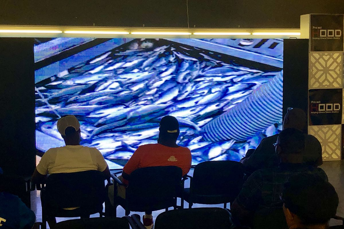 At a meeting Tuesday at Project H.O.O.D. headquarters, 6330 S. King Dr., attendees learned more about a job opportunity to relocate to Alaska for three months, beginning in September, to work in the fish processing industry.