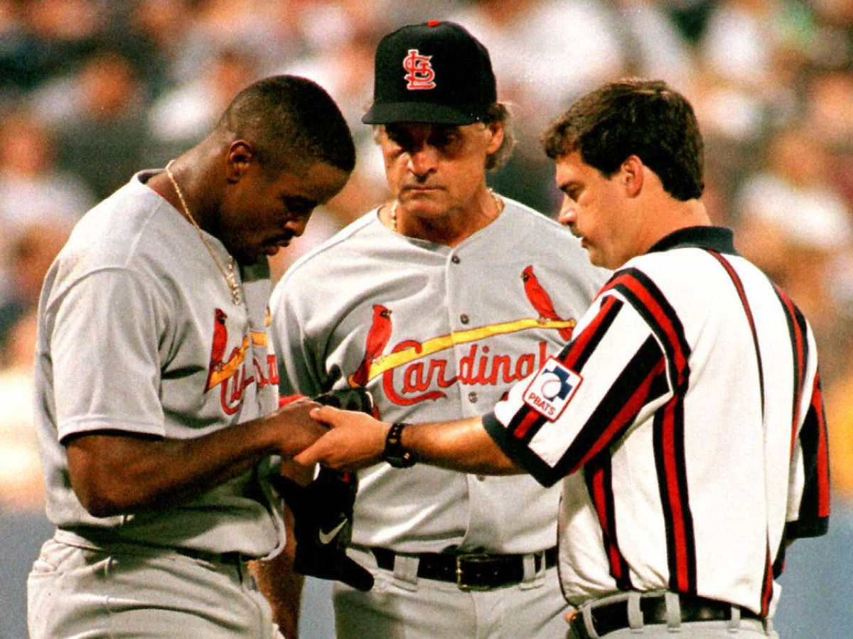 St. Louis Cardinals Brian Jordan (L) has his right