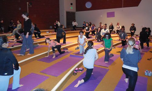 Students at GALS in Denver participate in a 40-minute yoga class.