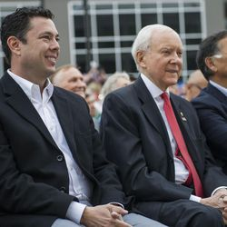 Rep. Jason Chaffetz, R-Utah, left, and Sen. Orrin Hatch, R-Utah, center, listen to speakers during the ribbon-cutting ceremony for Overstock.com's new Peace Coliseum office building in Midvale on Friday, Oct. 14, 2016. The project cost just under $100 million and occupies over 18 acres of land.