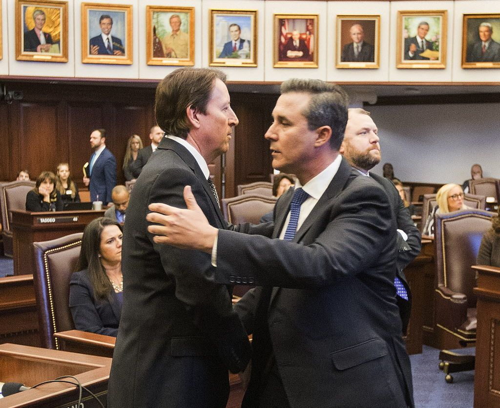 Florida Sen. Rene Garcia (right) embraces Sen. Bill Galvano after Galvano's bill, the Marjory Stoneman Douglas High School Student Safety Act, passed 20-18 at the Florida Capitol in Tallahassee, Florida, on March 5, 2018. | Mark Wallheiser/AP photo