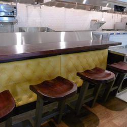 Four seats look right into the kitchen.