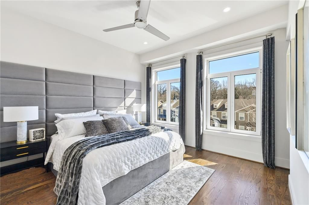 A white and gray bedroom with a large bed.