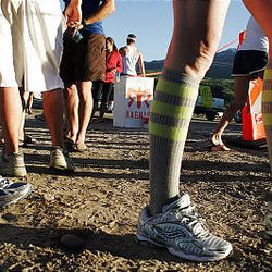 A couple of runners sport some retro tube socks near the exchange in Mountain Green as part of their costumes as they participate in the Ragnar Relay Wasatch Back race Friday.