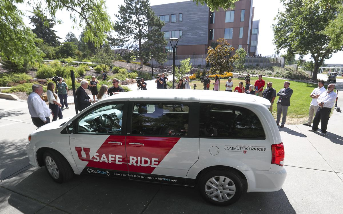 Alma Allred, executive director of commuter services at the University of Utah, top left, speaks during the launch of a pilot program called SafeRide at the U. campus in Salt Lake City on Thursday, Aug. 22, 2019. SafeRide provides a safe and reliable mode of transportation on campus to ensure safety during night hours. The free service is available to the university community but is especially meant to serve students on campus at night who need a ride to a parking lot, to their housing area or to another building on campus.