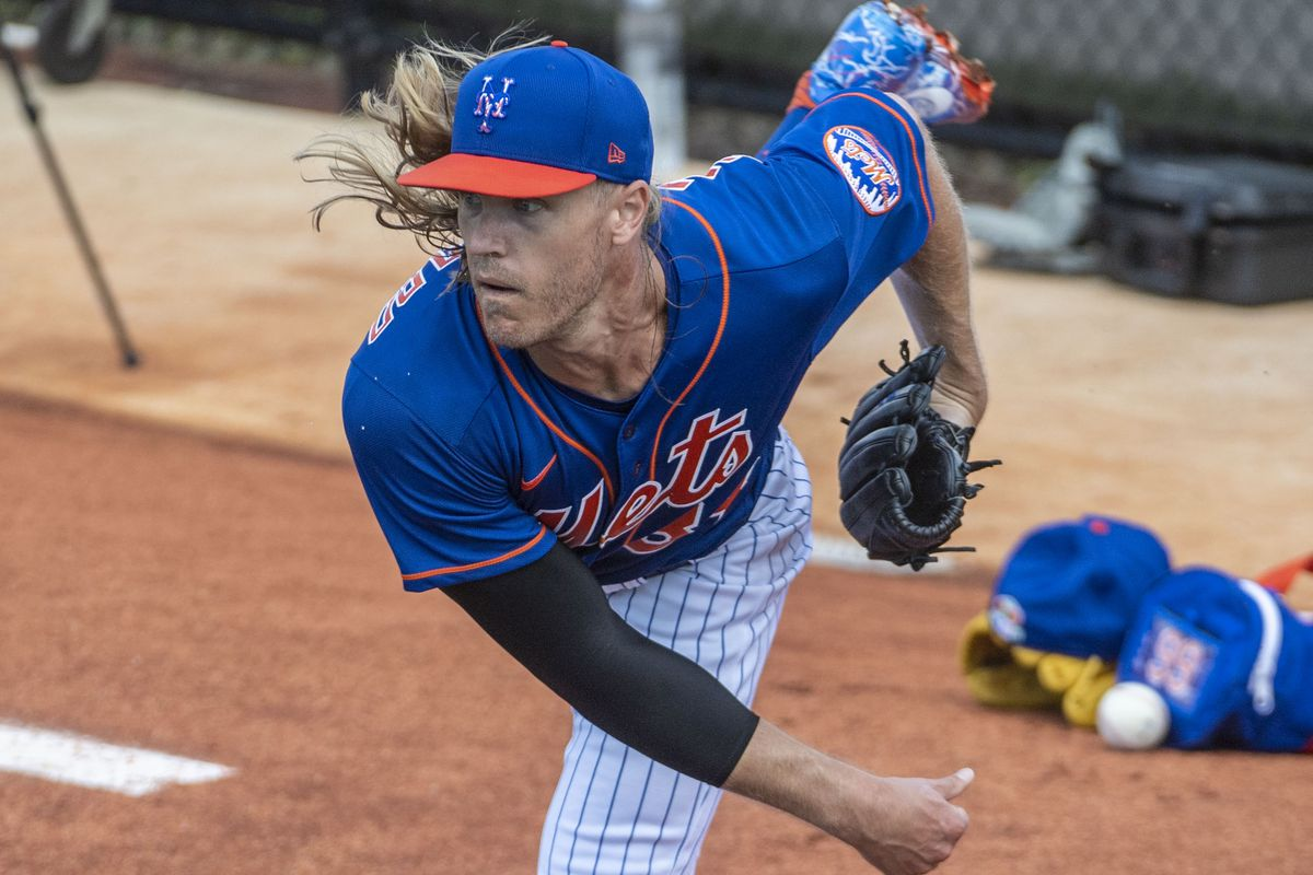 New York Mets pitcher Noah Syndergaard throws during spring training workout in Port St. Lucie, Fla.