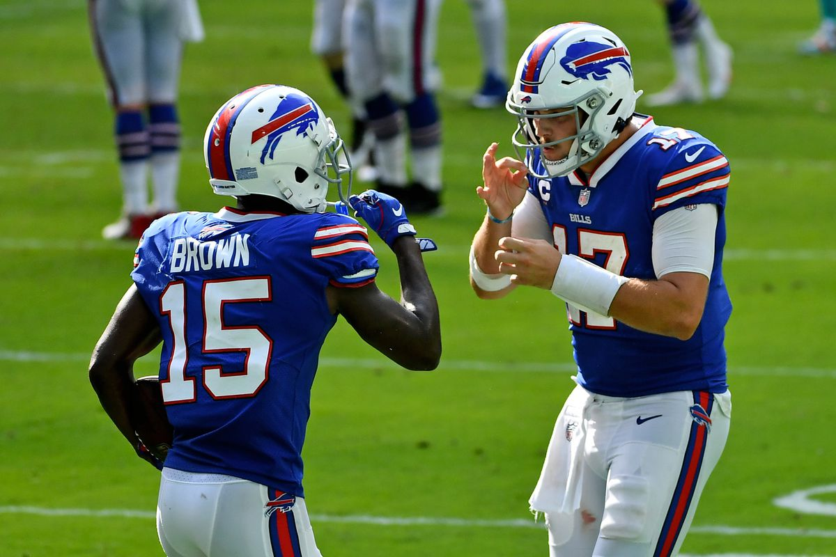 Buffalo Bills quarterback Josh Allen (17) celebrates with wide receiver John Brown (15) after a touchdown during the second half against the Miami Dolphins at Hard Rock Stadium.