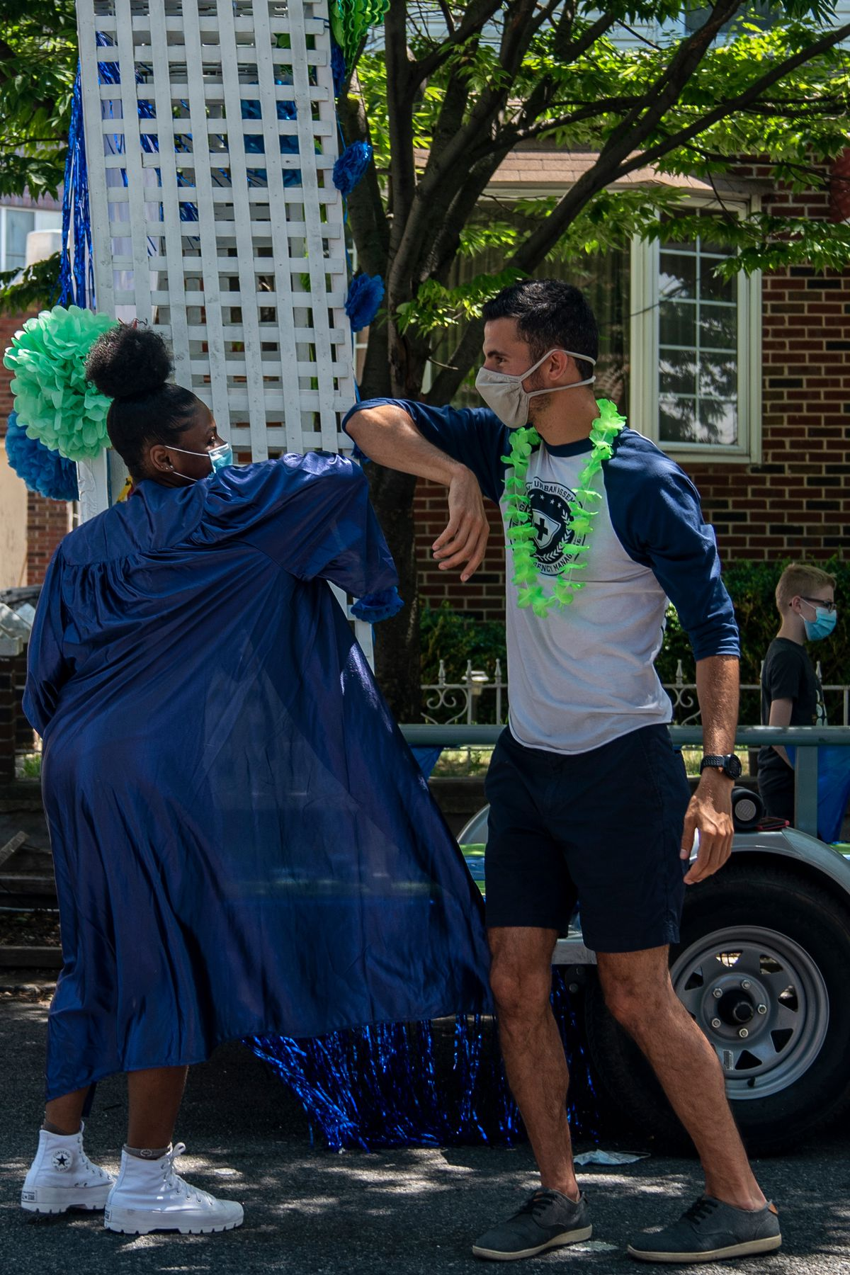 Principal, Rob Migliaro, greets Valedictorian, Nefertina Carr, near her home, June 25, 2020. It took Migliaro about 20 hours to organize a route, design a float and distribute all the information needed to make the Thursday and Friday tours possible.