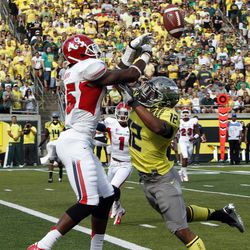 Oregon defender Brian Jackson, right, breaks up a pass intended for Fresno State receiver Davante Adams during the first half of an NCAA college football game in Eugene, Ore., Saturday, Sept. 8, 2012.