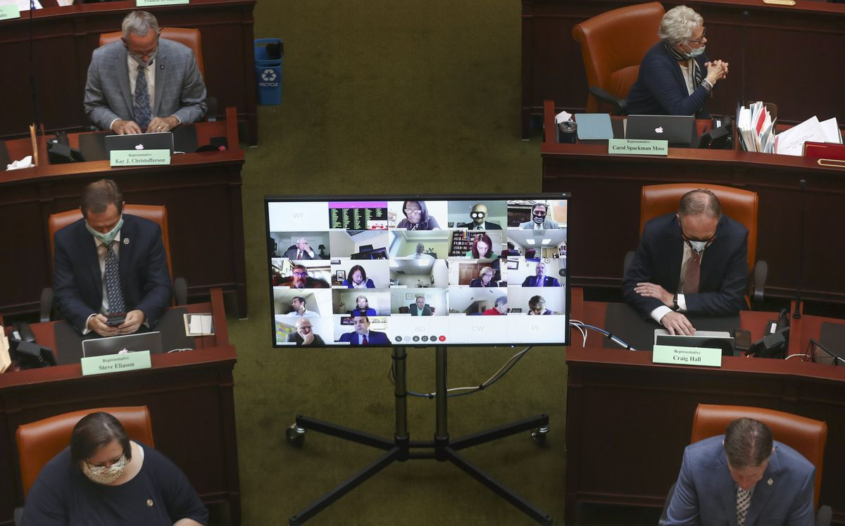 Legislators in the House of Representatives attend a special session in person and virtually to deal with myriad COVID-19 budget changes at the Capitol in Salt Lake City on Thursday, June 18, 2020.