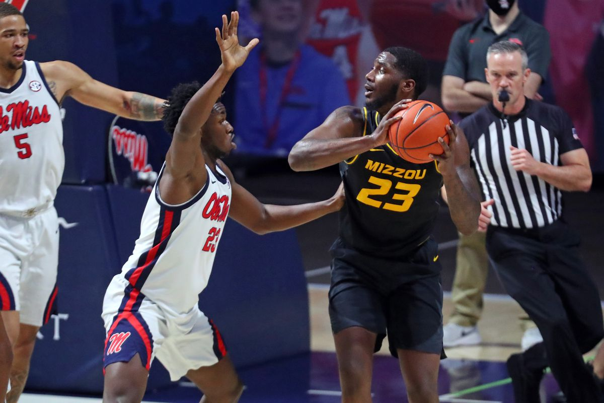 Missouri Tigers forward Jeremiah Tilmon looks for an open lane as Mississippi Rebels forward Sammy Hunter defends during the first half at The Pavilion at Ole Miss.